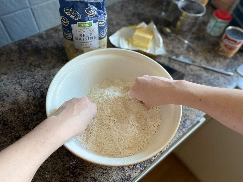 Rubbing flour and butter together for easy Scottish scone recipe