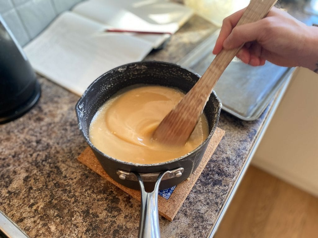 Stirring tablet mixture off the stove top