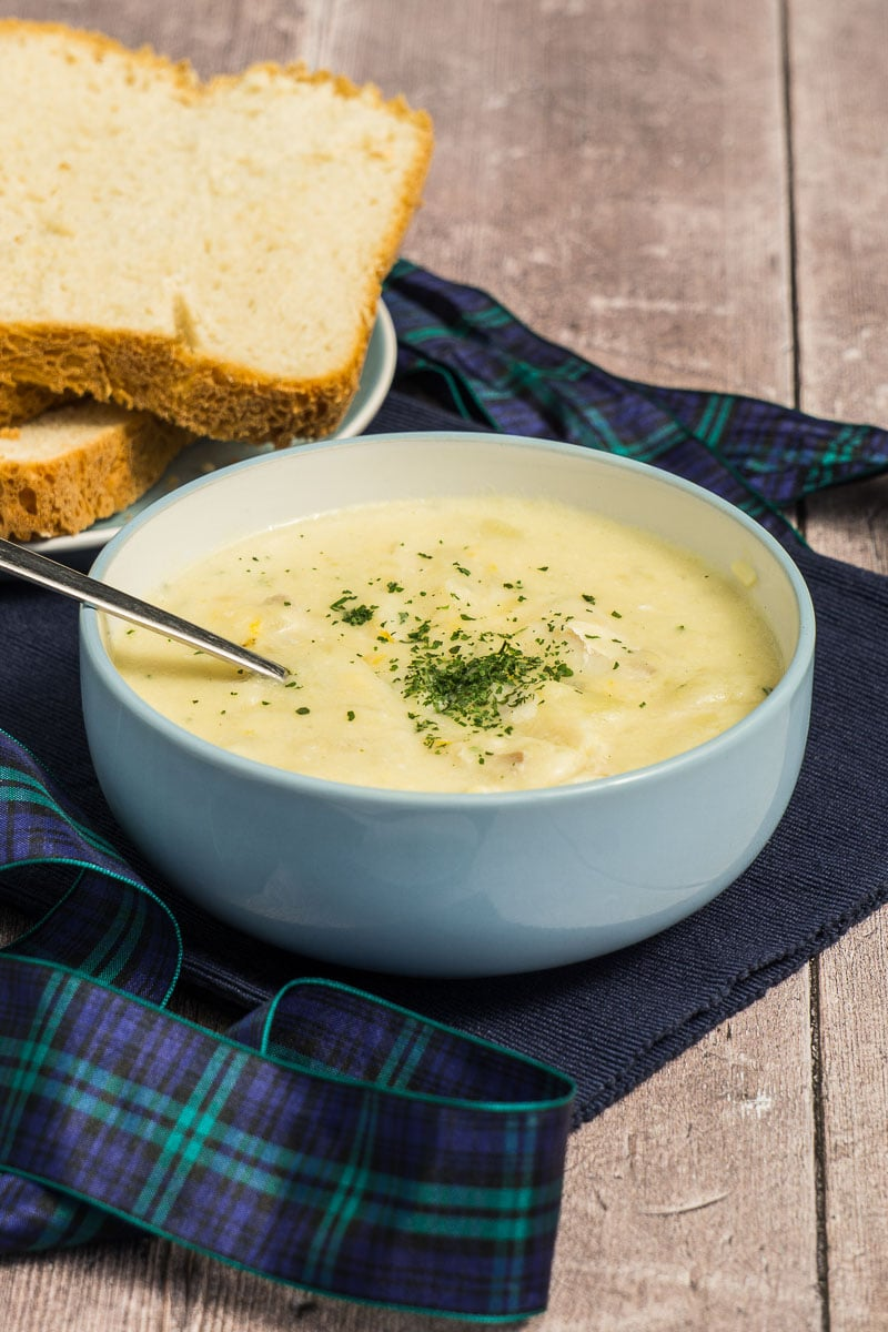 Cullen Skink Soup Recipe - Soup in a bowl with bread