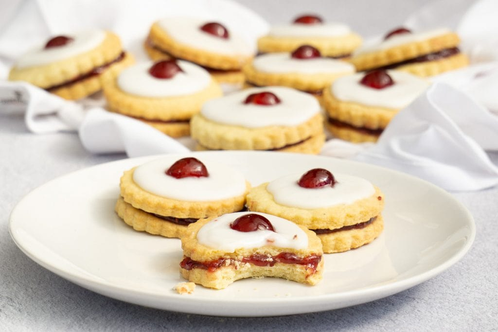 How to Make Empire Biscuits Recipe - Scottish Empire Biscuits on a plate with a bite taken out of one