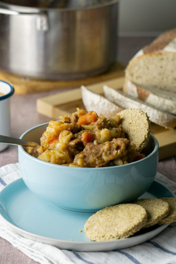 How to make Stovies - Scottish Stovies Recipe in a bowl with oatcakes, bread, and pot
