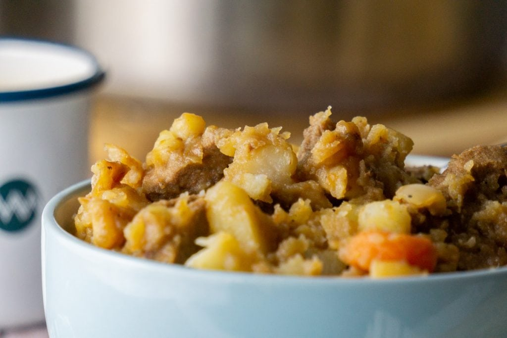 How to make Stovies - Scottish Stovies Recipe in a bowl with a cup of tea