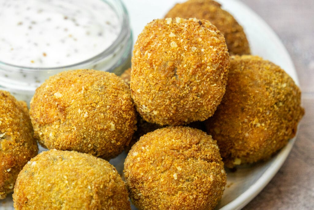 Haggis Bon Bons Recipe - Haggis Balls on a plate with whisky dipping sauce